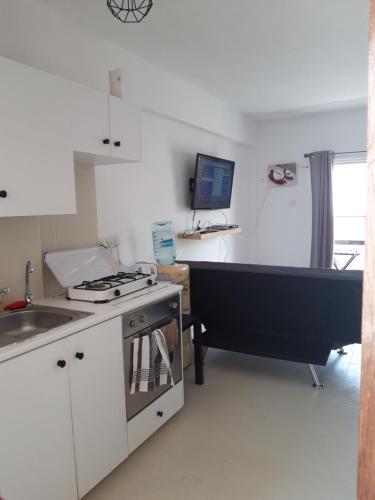 O bucătărie sau chicinetă la Kalogera Central
