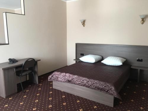 Кровать или кровати в номере Отель Плаза