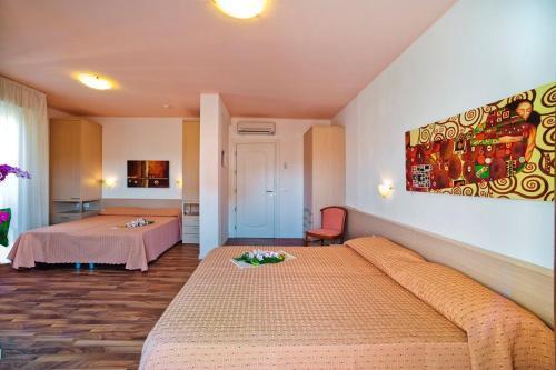Postel nebo postele na pokoji v ubytování Hotel Victoria