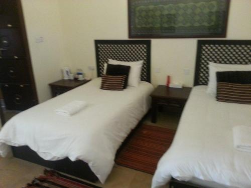 A bed or beds in a room at Desert Nights Camp