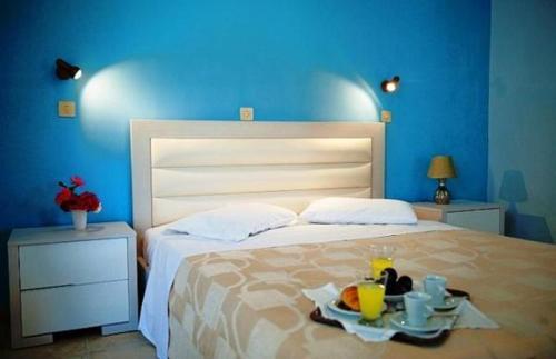 Letto o letti in una camera di Elea Hotel Apartments and Villas