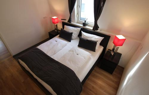 Ein Bett oder Betten in einem Zimmer der Unterkunft Apart Hotel Paradies