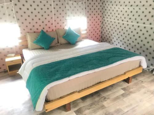 A bed or beds in a room at North Deodar Camps