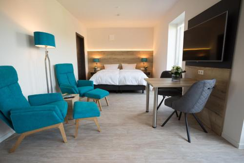 A bed or beds in a room at @home Boardinghouse