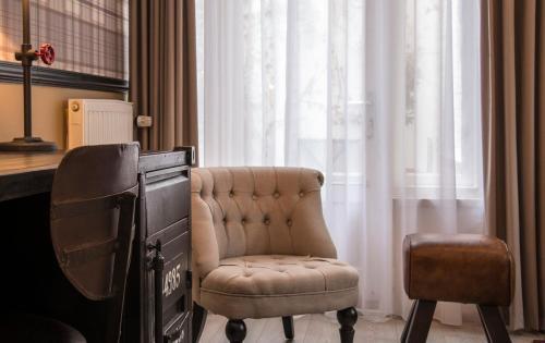 Coin salon dans l'établissement Max Brown Hotel Canal District
