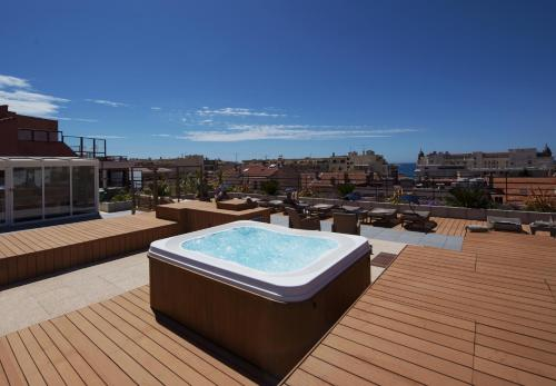 The swimming pool at or near Best Western Plus Le Patio des Artistes Wellness Jacuzzi