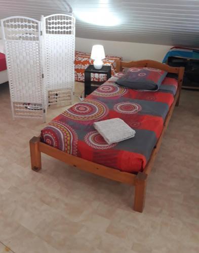 Cama ou camas em um quarto em Manava Tahara'a back packers