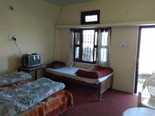 A bed or beds in a room at Shubham Home Stay