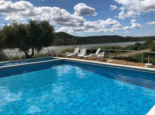 The swimming pool at or near Paisagem do Guadiana Turismo Rural