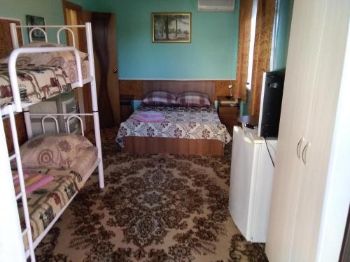 Кровать или кровати в номере Tatiana Guesthouse