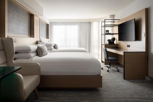 A bed or beds in a room at Vancouver Airport Marriott Hotel