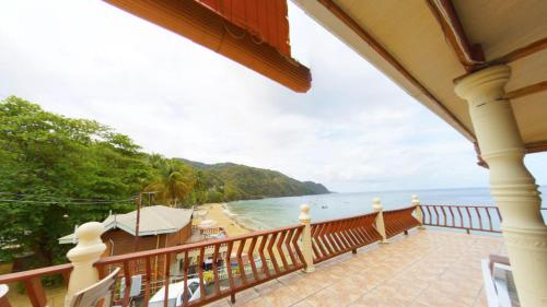 A balcony or terrace at The Naturalist Beach Resort