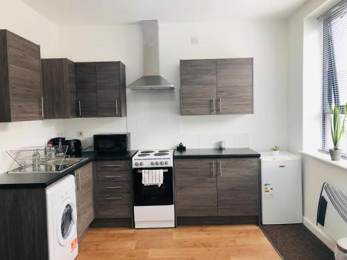 A kitchen or kitchenette at Showcase Apartments - Highcross House