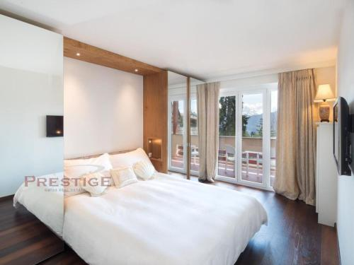 A bed or beds in a room at Apartment Genziana B