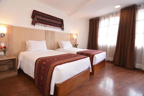 Cama o camas de una habitación en Hotel Prisma Cusco