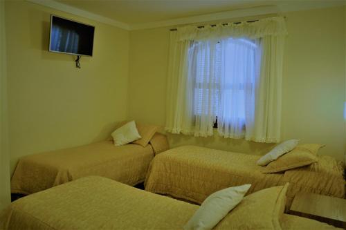 Cama ou camas em um quarto em Hotel Bologna