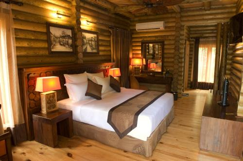A bed or beds in a room at Philea Resort & Spa