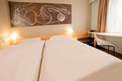 Кровать или кровати в номере ibis Jena City
