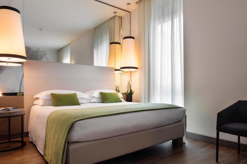 Un ou plusieurs lits dans un hébergement de l'établissement Starhotels Echo