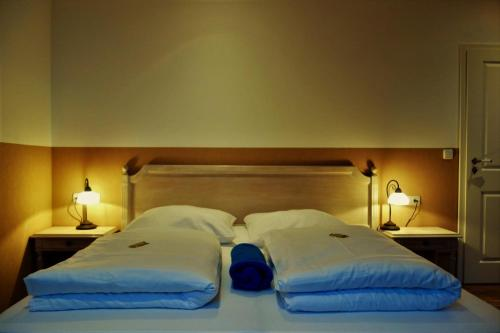 A bed or beds in a room at Rollys Hof