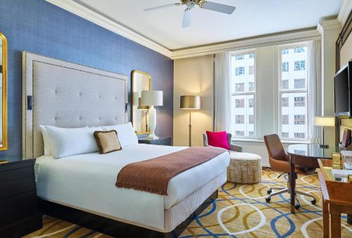 A bed or beds in a room at The Brown Palace Hotel and Spa, Autograph Collection