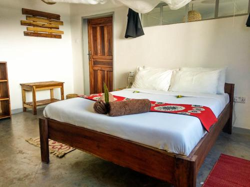 A bed or beds in a room at Kamunjila Lodge