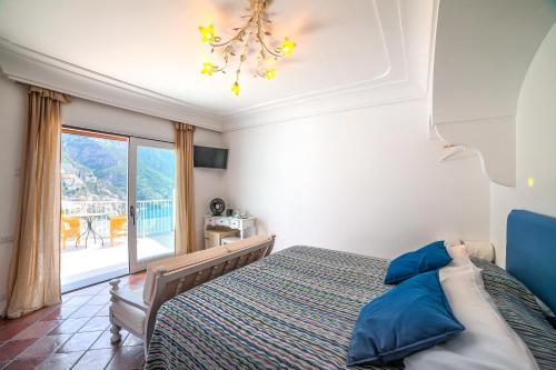 Letto o letti in una camera di Villa Anfitrite