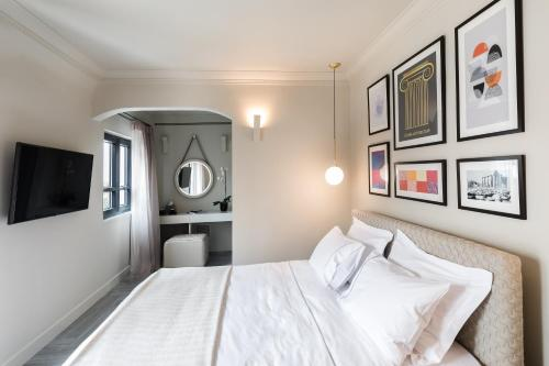 A bed or beds in a room at Oniro City