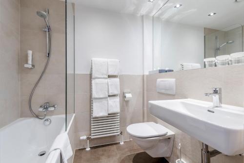 Ein Badezimmer in der Unterkunft Hotel IMLAUER & Bräu