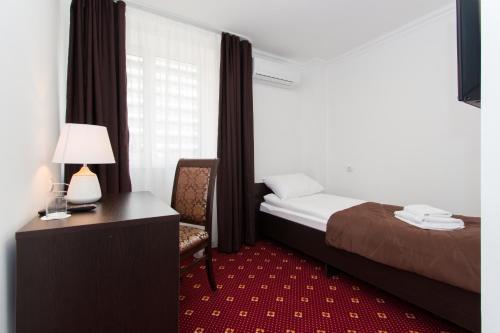 A bed or beds in a room at Аtria Hotel