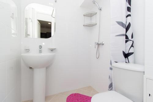 A bathroom at Аtria Hotel