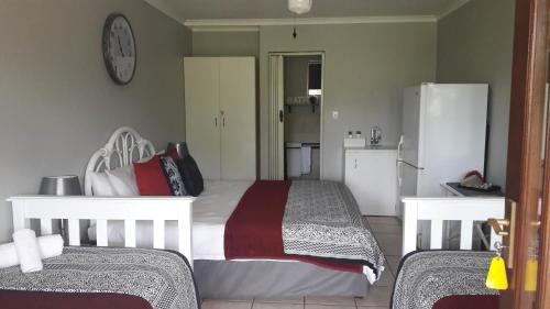 A bed or beds in a room at African Sun Guest House