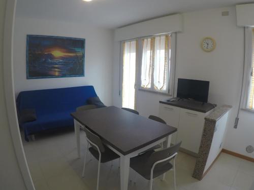 TV a/nebo společenská místnost v ubytování Appartamento Tintoretto