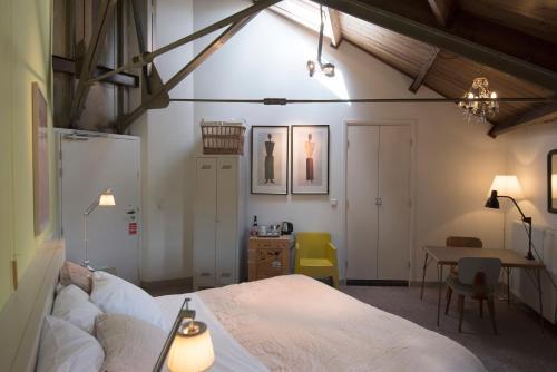 Een bed of bedden in een kamer bij Villa Augustus