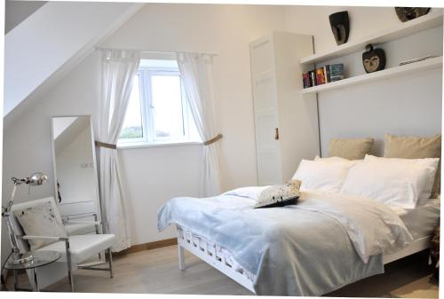 A bed or beds in a room at The Acorns