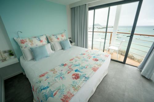 Cama o camas de una habitación en Hotel Boutique La Marquesina - Adults Only