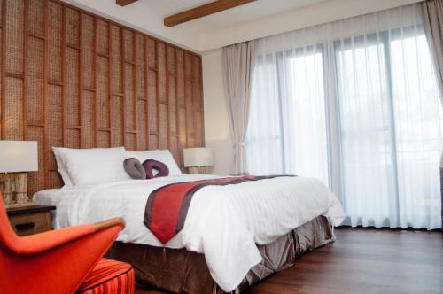 A bed or beds in a room at Su Beautiful Home Stay