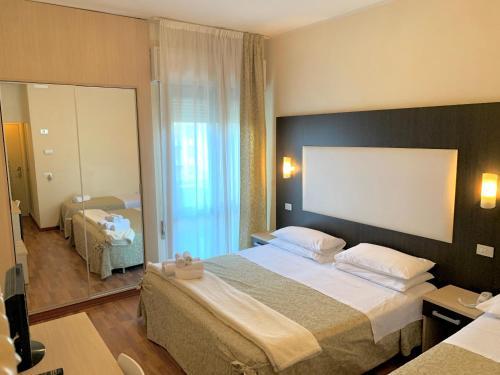 Letto o letti in una camera di Hotel Baby