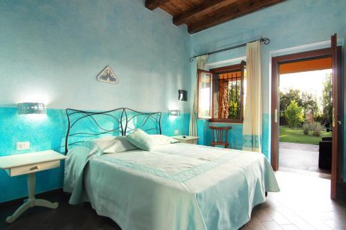 A bed or beds in a room at Su Passu Villa Privata