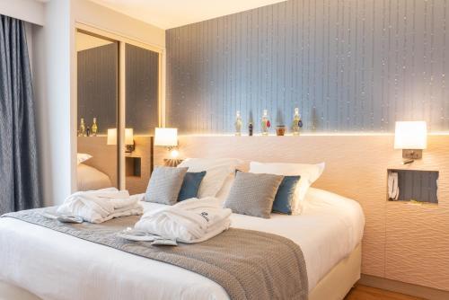 Un ou plusieurs lits dans un hébergement de l'établissement Résidence La Closerie Deauville