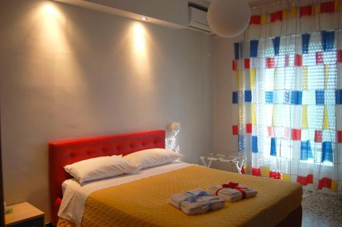 A bed or beds in a room at La Locomotiva