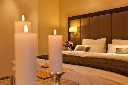 Кровать или кровати в номере Hotel Favor