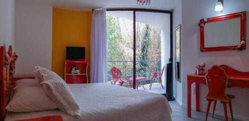 A bed or beds in a room at HOTEL EL PAN NUESTRO