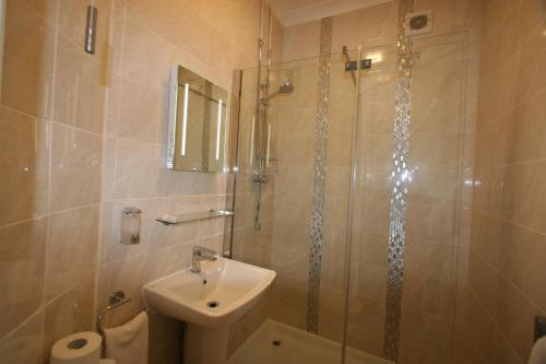 A bathroom at Grange Moor Hotel
