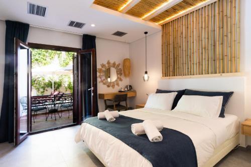 Ένα ή περισσότερα κρεβάτια σε δωμάτιο στο Aktaion Beach Boutique Hotel