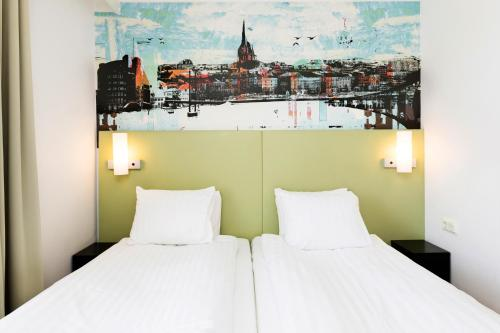 A bed or beds in a room at Good Morning+ Sundsvall