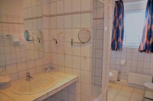 Ванная комната в Central Hotel