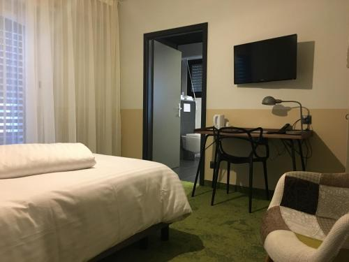 Кровать или кровати в номере Hotel Restaurant au Floridor