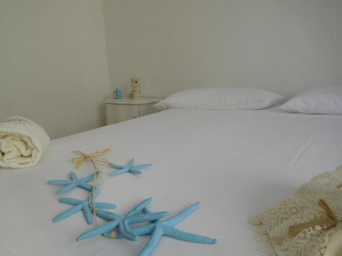 Letto o letti in una camera di Appartamento Capo di Leuca