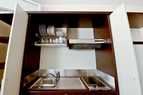 A kitchen or kitchenette at Cala Saracena Resort